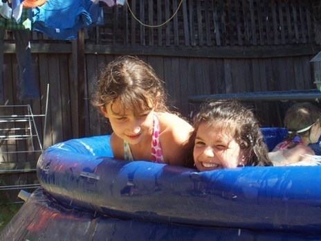 kids playing in inflatable pool