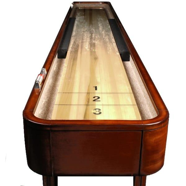 A Shuffleboard Table with a Burnished Mahogany Finish Over Solid Hardwood