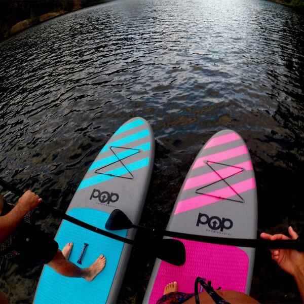 Blue and Pink Paddleboards Side by Side