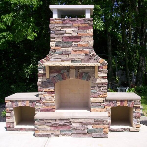 Stunning outdoor fireplace with mantel shelves wood storage - Miller Fireplace Project